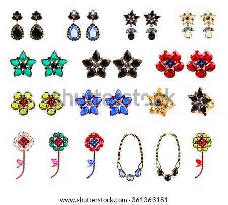 collection of crystal jewelry, earrings, rings, necklaces and brooches isolated on white background - stock photo