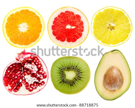 collection of cut tropical fruits on a white - stock photo