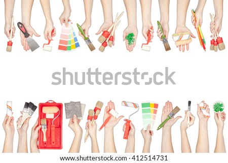 collection of decorating and house renovation tools in a hands isolated on white background - stock photo