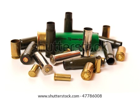 Collection of different empty bullet shells on white - stock photo