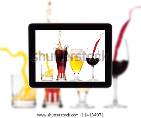 Collection of different images of alcohol on a Digital Tablet screen - stock photo