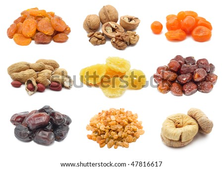 Collection of dried fruits and nuts isolated on white - stock photo