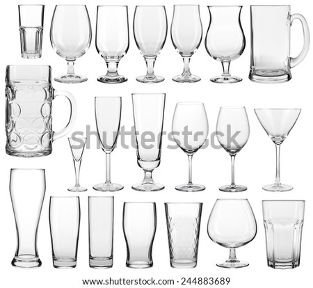 Collection of empty glassware on white background  - stock photo
