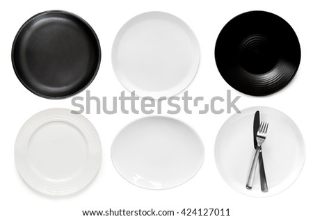 Collection of empty plates, top view, isolated on white. - stock photo