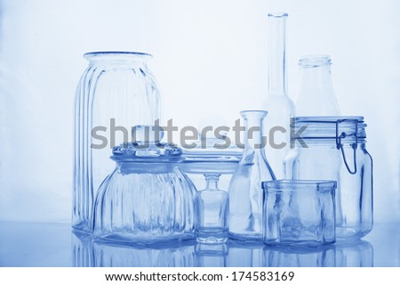 Collection of empty various glassware on light background.