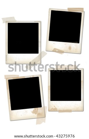 Collection of empty vintage photo frames. - stock photo