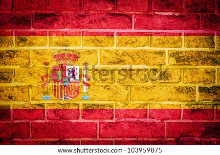 Collection of european flag on old brick wall texture background, Spain - stock photo
