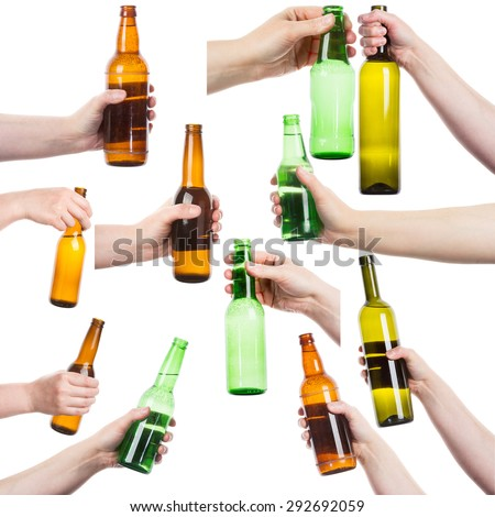 Collection of female hands holding various bottles of alcohol isolated on white background