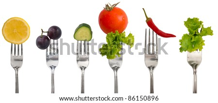 collection of forks with vegetables and fruit - stock photo