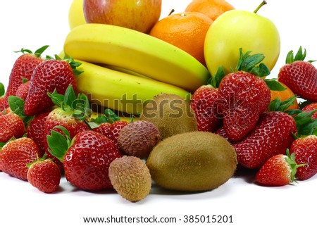 Collection of fresh fruits rich in vitamins : banana, strawberries, apple, clementine, kiwi, litchi,