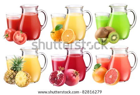 Collection of fresh juices in pitchers. Nearby are the ingredients of juices. - stock photo