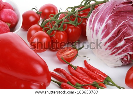 Collection of fresh red vegetables on white background, tomatoes, peppers, cabbage, radish, top view - stock photo