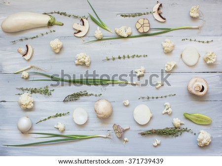 Collection of fresh white green toned vegetables and fruits raw produce on wood rustic background. - stock photo