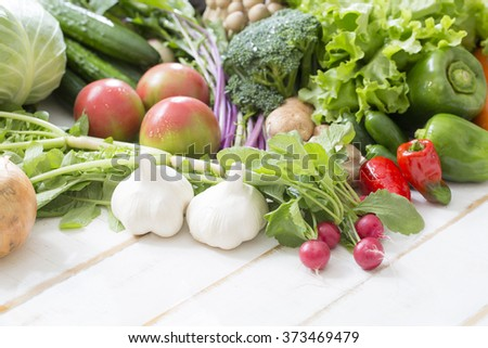 Collection of garlic and fresh vegetables - stock photo