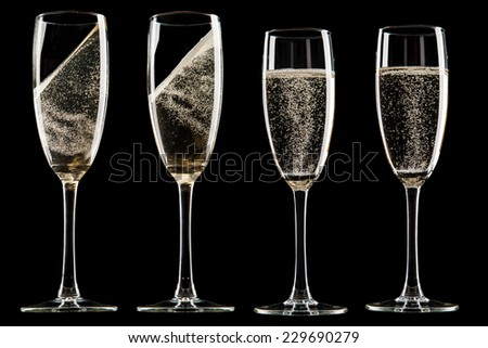Collection of glasses of champagne on black background - stock photo