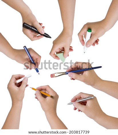 Collection of hands holding different stationary objects - stock photo