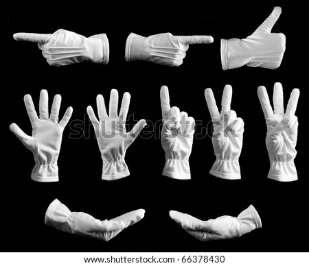 Collection of hands in white glove on black background. - stock photo