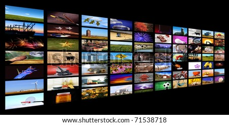 Collection of images forming the appearance of tv monitors falling of in the distance with black background, all images shot by me - stock photo