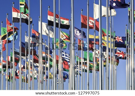 Collection of international flags against a blue sky