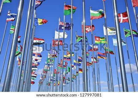 Collection of international flags against a blue sky - stock photo