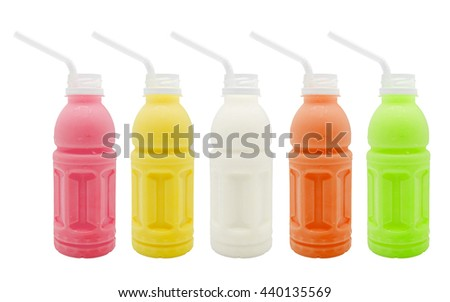 Collection of juice bottles and straw isolated on a white background.