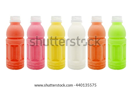 Collection of juice bottles isolated on a white background.