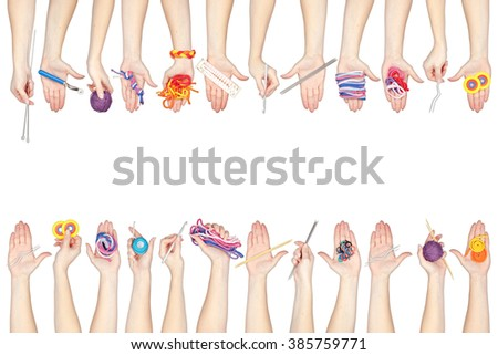 collection of knitting and knotting tools and threads in a hands isolated on white background - stock photo