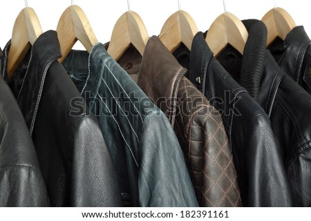 collection of leather jackets on hangers - stock photo