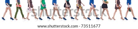 collection of legs and purses - women carrying fashion purses walking forward - stock photo