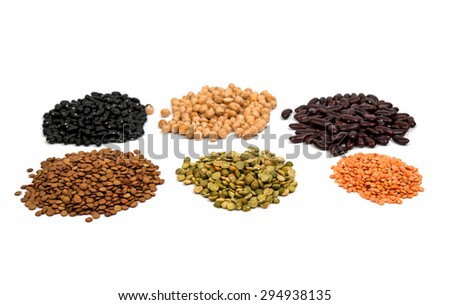 collection of legumes (chickpeas, green peas, red lentils, canadian lentils,  yellow lentils, yellow peas, red beans) isolated on white background - stock photo