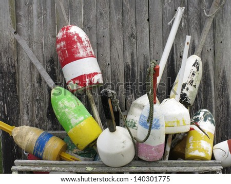 Collection of lobster trap buoys in Cape Cod, Massachusetts - stock photo