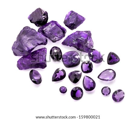 Collection of many shapes faceted and raw unpolished amethyst gemstones isolated on the white background. - stock photo