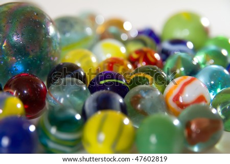 collection of marbles on white background - stock photo