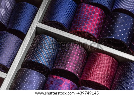 collection of neckties on drawer's shelf