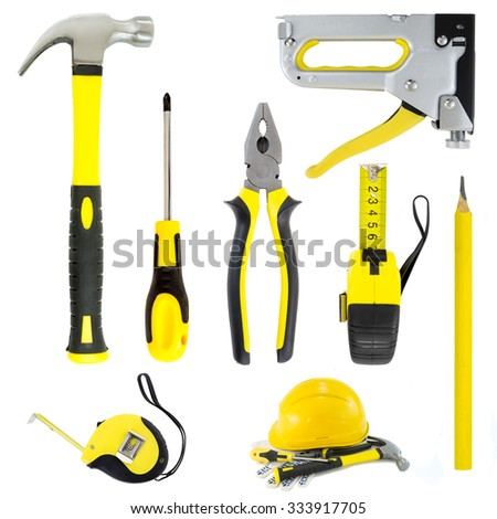 Collection of new yellow carpenter diy tools isolated on a white background. Tools series. - stock photo