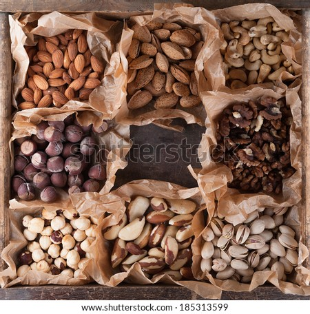 Collection of nuts in a wooden box. Top view. - stock photo