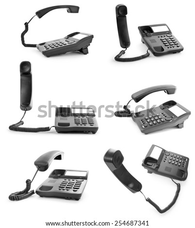 Collection of office phones with the handset lifted upwards - stock photo