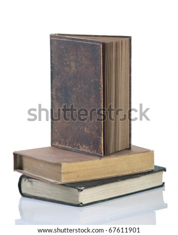 Collection of old books on white background - stock photo