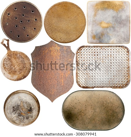 Collection of old metal plates isolated on white background - stock photo