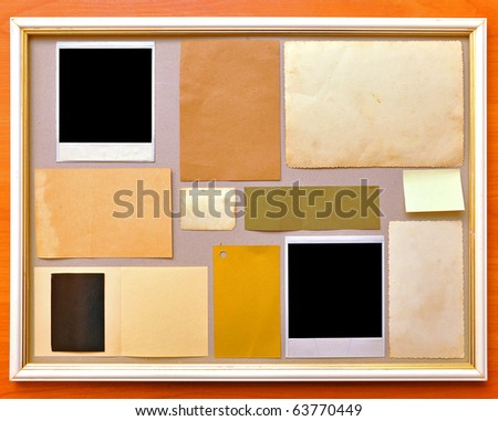 collection of old photographs in a frame - stock photo