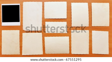 collection of old photos on wood background - stock photo