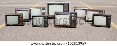 Collection of old TV sets - stock photo
