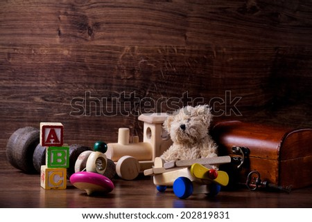 collection of old wood children toys with teddy bear - stock photo
