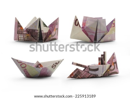 collection of origami ships of five hundred euro banknotes - stock photo