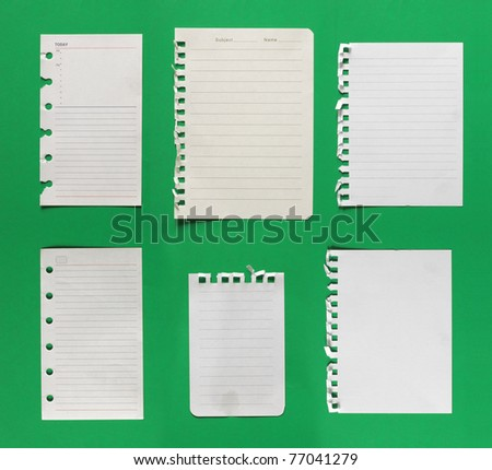 collection of paper. isolated over green background - stock photo