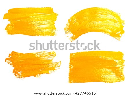 Collection of photos yellow strokes of the paint brush isolated on a white - stock photo