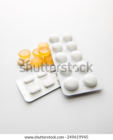 collection of pills and capsules