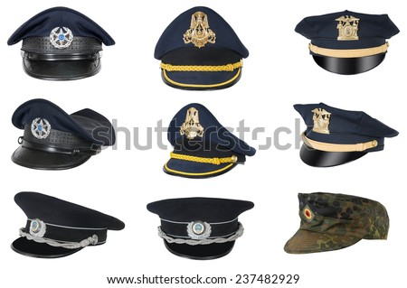 Collection of police peak-caps. - stock photo