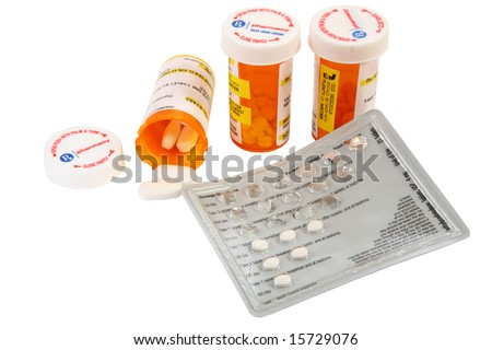 Collection of prescription medicines over white. - stock photo