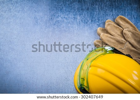 Collection of protective workwear on scratched metallic background top view construction concept. - stock photo
